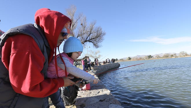 Raul Zapata teaches his 3-year-old daughter Zada Zapata to fish during a spring 2018 Kid Fish Rally at Ascarate Lake.