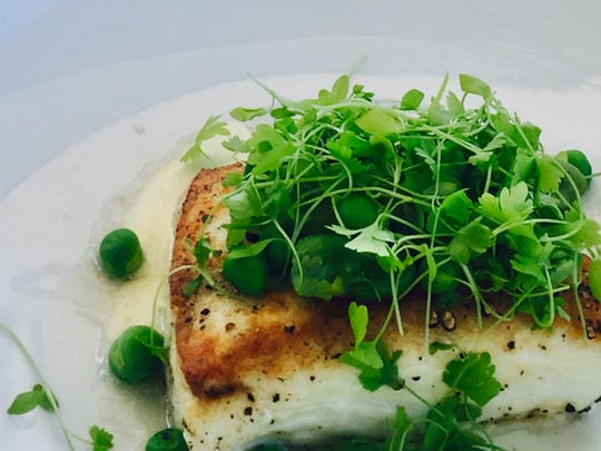 Seared halibut, minted fava beans, pea ragout and vanilla parsnip purée, a seasonal dish at Jake's Restaurant, 21445 W. Gumina Road, Pewaukee.