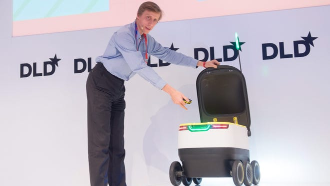 Ahti Heinla of Starship Technologies presents a wheeled delivery robot at the DLD (Digital-Life-Design) conference in Munich,Jan, 18 2016.