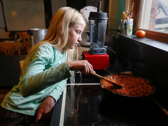 Anna Millsap stirs the ratatouille that was being made