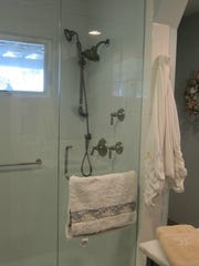 The downstairs bathroom was remodeled as part of making a master suite.