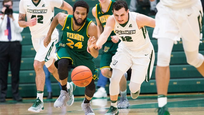 Binghamton University guard John Rinaldi, right, races Vermont guard Dre Willis to a loose ball during the first half of Wednesday's America East Conference men's basketball game at the Events Center. Binghamton lost, 67-50.