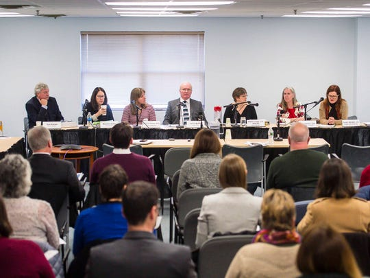 The Green Mountain Care Board meets in Montpelier on Thursday, December 21, 2017. From left to right are board members Tom Pelham, Maureen Usifer, Jessica Holmes, Kevin Mullen and Robin Lunge. Seated next to them are the board's general counsel Judy Henkin, second from right, and executive director Susan Barrett.