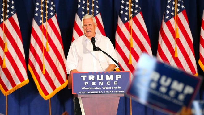 Indiana Gov. Mike Pence, Donald Trump's running mate, speaks at the Waukesha County Exposition Center Center. - Image credit: