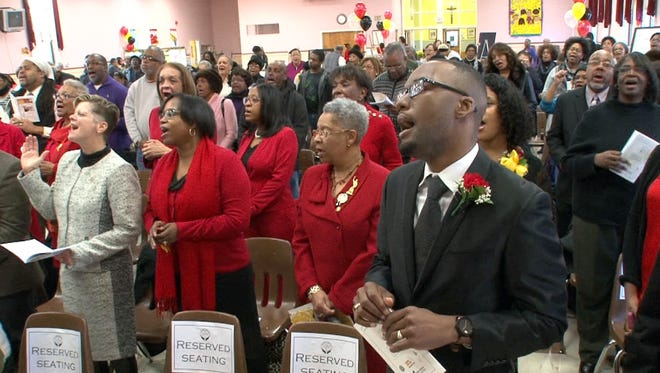 Pastor Zaniek T.M. Young from the Shrewsbury A.M.E. Zion Church in Red Bank joins in on the musical celebration during the Martin Luther King Day celebration held at Our Lady of Mount Carmel School in Asbury Park Monday, January 18, 2016.