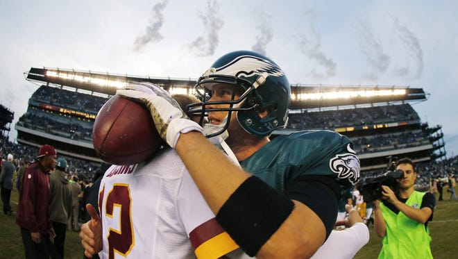 PHILADELPHIA, PA - NOVEMBER 17:Quarterback Nick Foles #9 of the Philadelphia Eagles hugs back up quarterback Kirk Cousins #12 of the Washington Redskins after a game at Lincoln Financial Field on November 17, 2013 in Philadelphia, Pennsylvania. The Eagles defeated the Redskins 24-16. (Photo by Rich Schultz /Getty Images)
