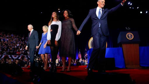 President Barack Obama waves on stage with first lady Michelle Obama, daughter Malia, Vice President Joe Biden and his wife Jill Biden after his farewell address at McCormick Place in Chicago, Jan. 10, 2017.