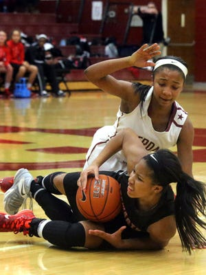 Riverdale's Anastasia Hayes and Stewarts Creek's Brianah Ferby fight a loose ball during last season's contest at Riverdale. The two meet at 6 p.m. Friday.