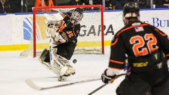 Mamaroneck's Tommy Spero (35) clears the puck in the