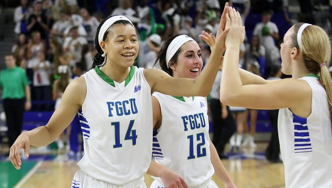 FGCU's Whitney Knight, left, celebrates after beating Stetson Amber on Saturday at Alico Arena in Fort Myers. Knight earned the Atlantic Sun Women's Basketball Player of the Week award following the opening weekend of conference play, announced by the league office on Monday.