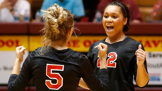 Nivonne Allen, right, and Emilee Cox of Lafayette Jeff celebrate a point against Logansport in the second set of the volleyball sectional Thursday, October 12, 2017, at McCutcheon High School. Jeff was swept by Logansport 16-25, 16-25, 12-25.