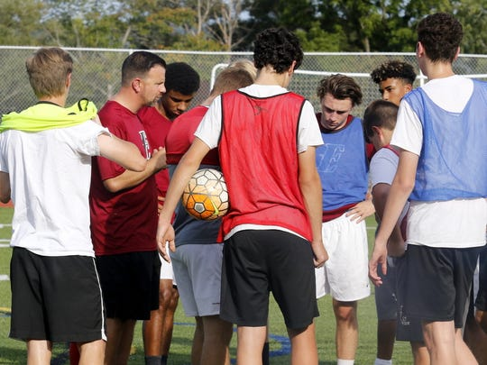 Elmira boys soccer coach Derek Hamilton talks to his players after a practice Sept. 12 at Ernie Davis Academy.