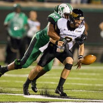Southern Miss quarterback Nick Mullens fumbles the ball as it was forced out by Marshall defensive lineman Gary Thompson during the their game on Oct. 9 at Joan C. Edwards Stadium in Huntington, West Virginia.