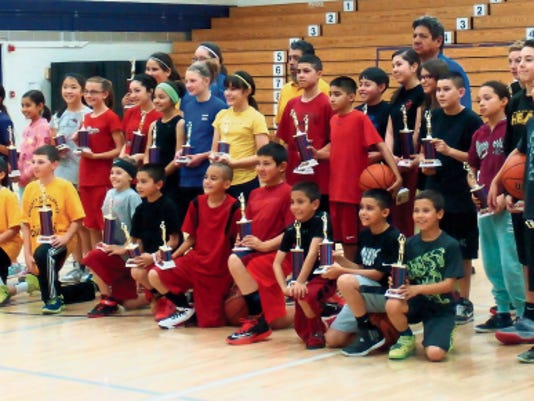 (Correction: An incorrect photo was published with Wednesday's free throw story.) Area youth competed in the Knights of Columbus state free throw championship in Albuquerque. Miguel Gonzales and Owen Herrera, pictured at the far right, represented the Ruidoso area.