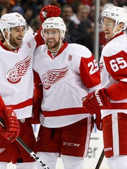 Red Wings center Frans Nielsen, left, celebrates with