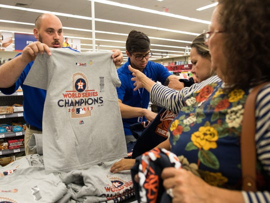 Fans buy Astros World Series Champions gear at Academy Sports and Outdoors in Corpus Christi  after their Game 7 win over the Los Angeles Dodgers on Wednesday, Nov. 1, 2017.