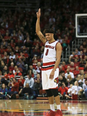Louisville's Damion Lee signals a trey against Western Kentucky's Saturday at the the KFC Yum! Center.