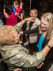 Outgoing Palm Springs City Council member Ginny Foat embraces Christy Holstege.