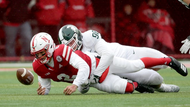 Nebraska's Adrian Martinez fumbles after being tackles by MSU defensive end Jacub Panasiuk in 2018. Panasiuk, now a fifth-year senior, will again be trying to corral Martinez, also now a senior, this Saturday at Spartan Stadium.