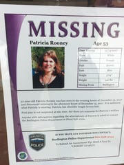 A police poster seeking help in finding Patricia Rooney, a Burlington resident missing since Dec. 13, is seen posted on a downtown window on Jan. 22, 2018. The poster incorrectly lists Rooney's age. It is 57.