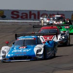 Drivers compete in the Six Hours of the Glen last year at Watkins Glen International.