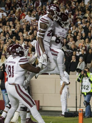 Mississippi State wide receiver Reginald Todd (20) and tight end Jordan Thomas (83) react after Thomas' touchdown during the third quarter of an NCAA college football game against Texas A&M.