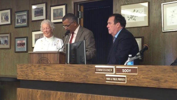 Irene Decker (left) accepts praise and a certificate from Millville Mayor Michael Santiago (center) and Vice Mayor James Quinn at Tuesday's City Commission meeting. Decker recently left the city's Industrial Commissioner after 29 years as an appointed member.