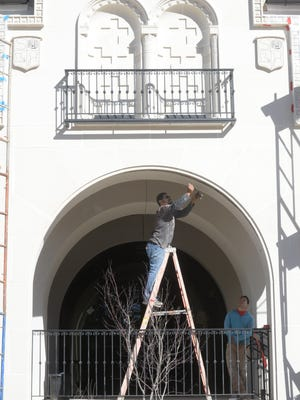 Miguel Rodriguez watches was Hector Rodiguez works on one of the archways at the new retail space nearly completed at 5821 Line Ave.