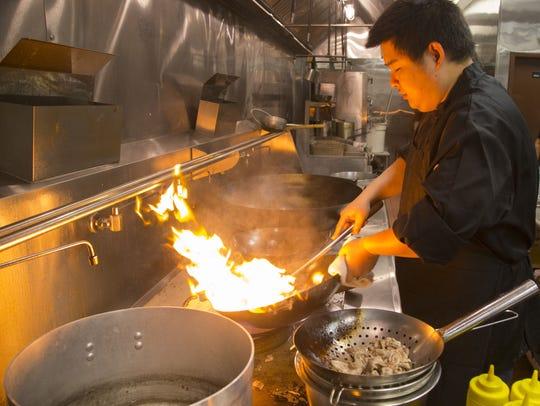 Jiang Niu prepares food at Shaanxi Chinese Restaurant