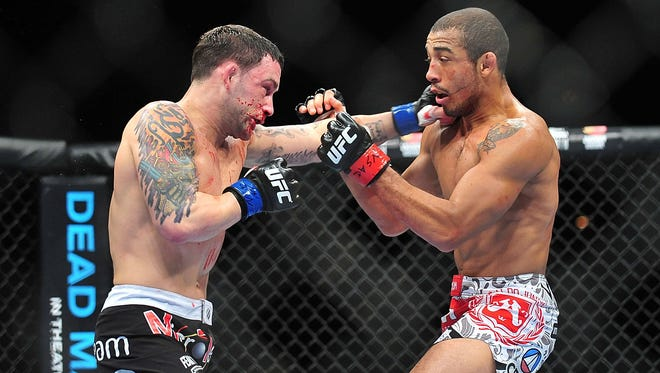 Jose Aldo, right, avoids a punch by Frankie Edgar during UFC 156 at Mandalay Bay last February.