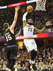 LeBron James goes in for  a dunk against the Phoenix Suns on Jan. 18, 2017.