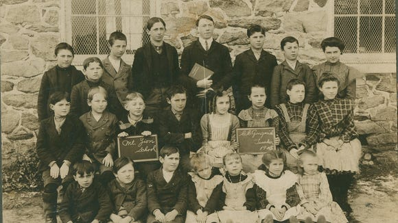 """Gary E. Heiland shared the above photo of Mount Zion School, taken in 1905, from his collection of old photos from the area. """"The name of the photographer, Wilson, 227 W. Market St., York, Pa., is embossed on the bottom of the heavy board frame,"""" he wrote. Pictured are, front row from left, Clarence Sipe, Murray Hoke, Wilbert Reever, Esther Moul, Florence Dayhoff, Florence Baily and Dora Sipe; second row, Charles Bailey, Harry Ferree, Chester Miller, Clarence Kohr, Mamie Shaffer, Naomi Beaverson, Bessie Gingerich and Sadie Kohr; and back row, Walter Spangler, Walter Hoke, Earle Beaverson, David Spangler, teacher Christopher Gingerich, Gary's uncle Walter Heiland, Gary's father John M. Heiland and Bessie Beaverson."""