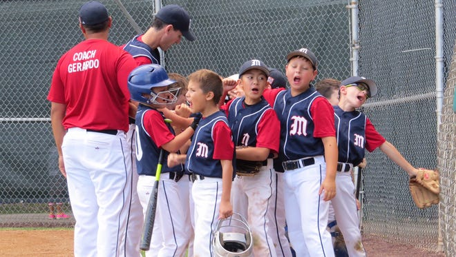 The Millburn 9U baseball team gets a pre-game pep talk from manager Justin Gerardo and coach Adam Stein.