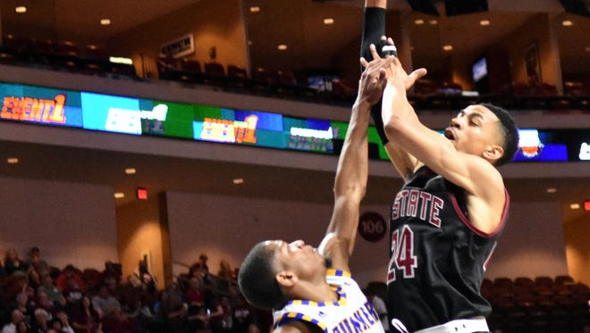 Matt Taylor (24) and the New Mexico State Aggies face Baylor in the NCAA Tournament on Friday in Tulsa, Okla.