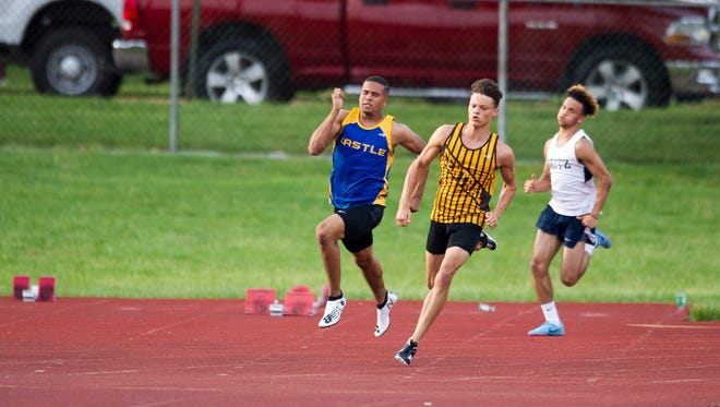 Central's Jalen Bowman rounds the corner in winning the 200-meter dash with a school-record time of 22.00 Thursday in the Central Sectional. He also set a school mark in the 100 (10.71).