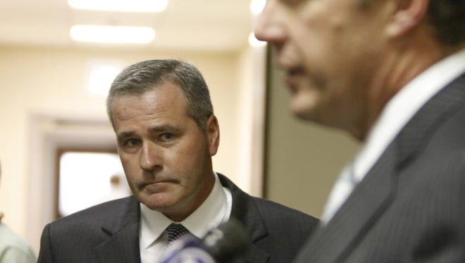 Daniel Lynch, left, stands with his attorney Michael Schiano outside court at the Hall of Justice in Rochester on Wednesday, Nov. 6, 2013.the Monroe County LDC scandal.