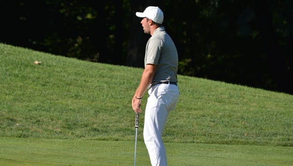 Cameron Young reacts after his birdie try on his last