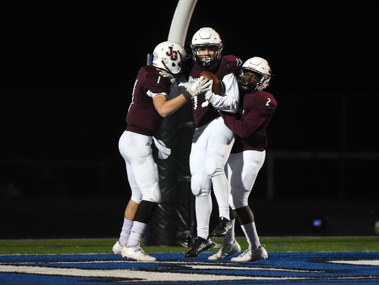 John Glenn celebrate's Gavin Thompson's touchdown against Philo. The Muskies aim for a state title berth against Clinton-Massie on Friday.
