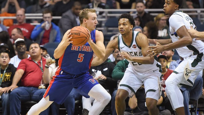 Pistons guard Luke Kennard (5) looks for a shot against Bucks guard Rashad Vaughn (20) in the fourth quarter of the Pistons' 107-103 exhibition loss on Friday, Oct. 13, 2017, in Milwaukee.