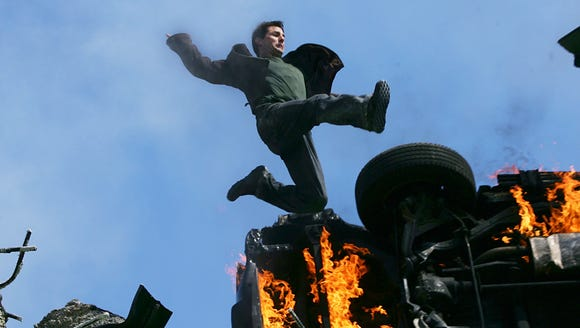 Tom Cruise take a flying leap (over flames, of course)