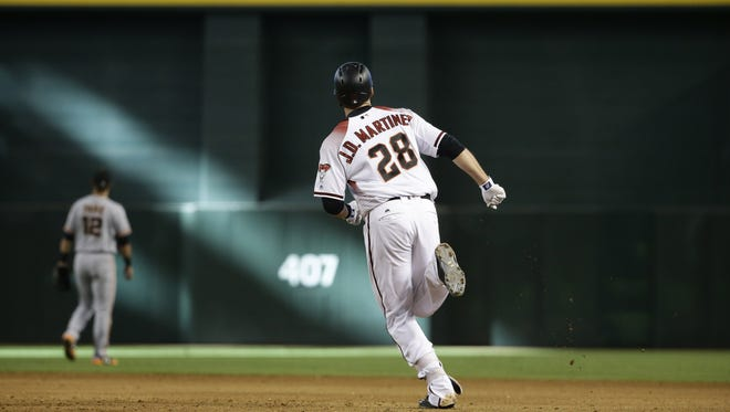 Arizona Diamondbacks J.D. Martinez rounds the bases after hitting a solo homerun against the San Francisco Giants in the 9th inning at Chase Field on Wednesday, Sep. 27, 2017 in Phoenix, Ariz.