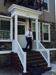 Yonkers police Sgt. Louis Venturino leaves 484 Walnut St. in Yonkers on Tuesday, the morning after a 4-year-old girl accidentally shot herself in the face.