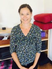 Mary Hilliker poses for a photo at 5 Koshas Yoga and