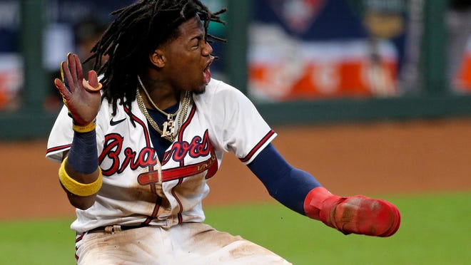 Atlanta Braves center fielder Ronald Acuna Jr. (13) celebrates after scoring a run the 3rd inning against the Miami Marlins during game one of the 2020 NLDS at Minute Maid Park.