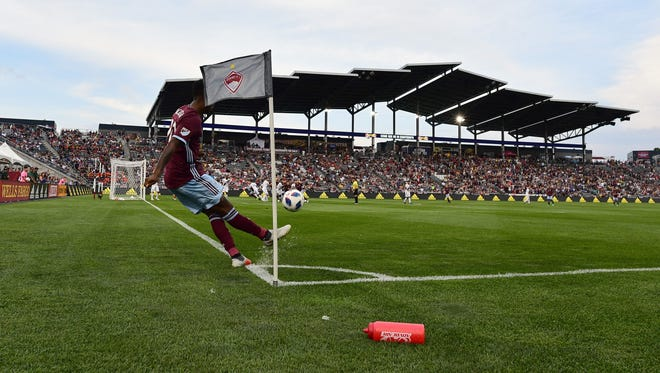 Colorado Rapids midfielder Kellyn Acosta corner kicks in the first half of the match against the Los Angeles Galaxy at Dick's Sporting Goods Park. Colorado won the game, 2-1.