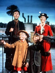 Bert (Dick Van Dyke), Mary Poppins (Julie Andrews), Jane (Karen Dotrice) and Michael (Matthew Garber) sing 'Chim Chim Cher-ee' in 'Mary Poppins.'