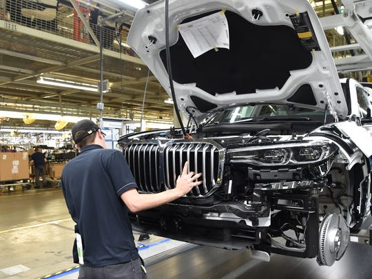 A BMW associate examines a pre-production X7 model at the assembly plant in Spartanburg County. The SUV will be in full production by the end of 2018.