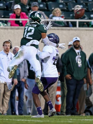 MSU's R.J. Shelton leaps over a Northwestern defender in an attempt to make a catch in the second half of last week's loss to Northwestern. Shelton leads MSU with 28 catches for 452 yards and four touchdowns in six games this season.
