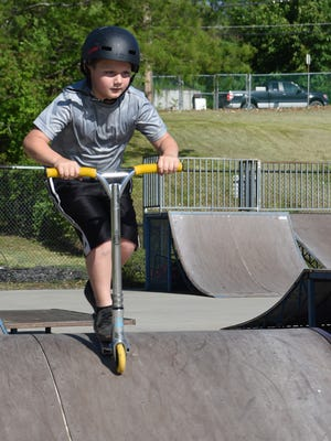 Jayden Mihalchik, 9, of Wappingers Falls rides his scooter around the skate park at Victor C. Waryas Park in the City of Poughkeepsie.