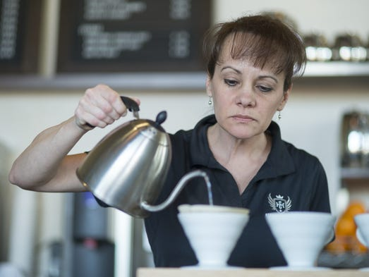 Sara Bruin, General Manager, makes herself a pour over
